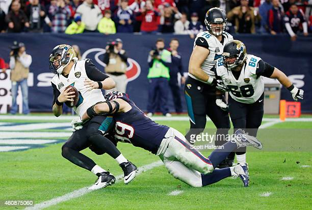 Blake Bortles of the Jacksonville Jaguars is sacked by JJ Watt of the Houston Texans in the fourth quarter during their game at NRG Stadium on...