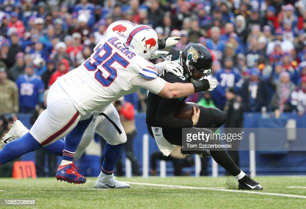 Blake Bortles of the Jacksonville Jaguars is sacked by Kyle Williams of the Buffalo Bills and Jerry Hughes in the third quarter during NFL game...