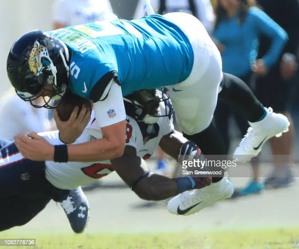 Blake Bortles of the Jacksonville Jaguars is tackled by Andre Hal of the Houston Texans during the game at TIAA Bank Field on October 21 2018 in...