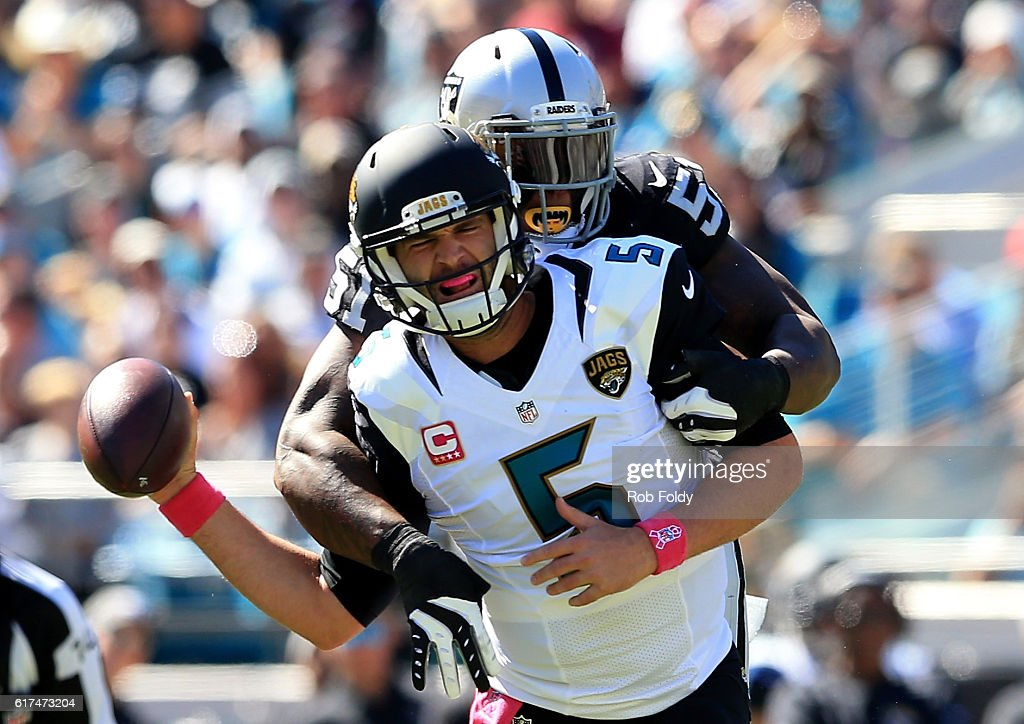 Blake Bortles #5 of the Jacksonville Jaguars is tackled by Bruce Irvin of the Oakland Raiders during the game at EverBank Field on October 23, 2016 in Jacksonville, Florida.