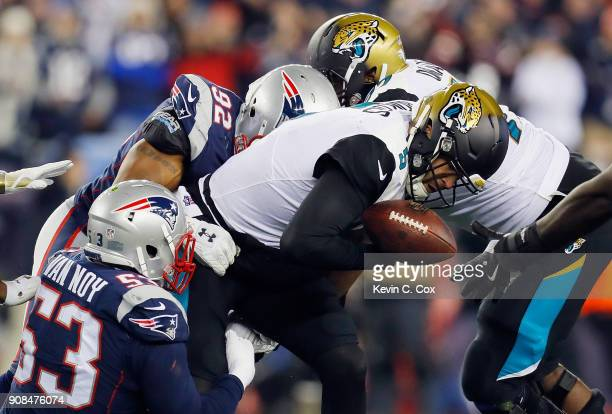 Blake Bortles of the Jacksonville Jaguars is tackled by Kyle Van Noy of the New England Patriots in the fourth quarter during the AFC Championship...