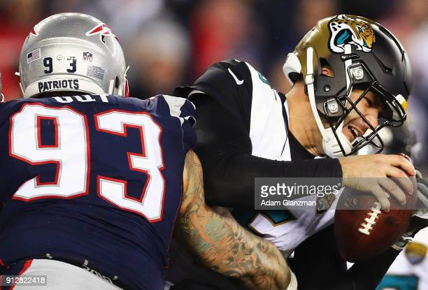 Blake Bortles of the Jacksonville Jaguars is tackled by Lawrence Guy of the New England Patriots in the third quarter during the AFC Championship...