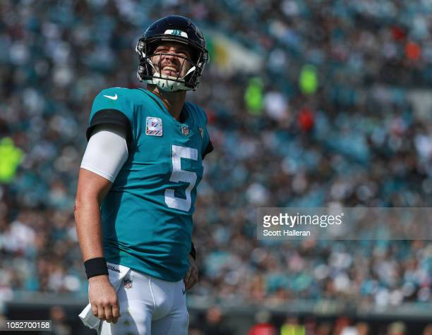 Blake Bortles of the Jacksonville Jaguars looks at the scoreboard during the second half against the Houston Texans at TIAA Bank Field on October 21...