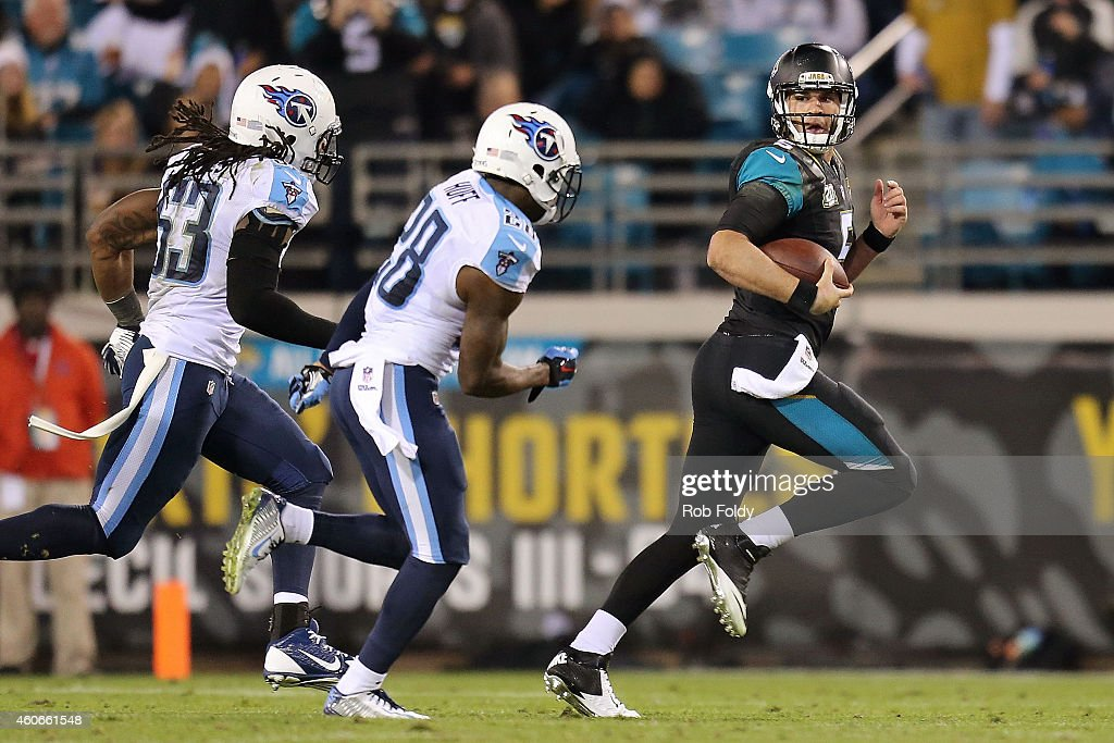 Blake Bortles #5 of the Jacksonville Jaguars looks back as he runs past Marqueston Huff #28 and Quentin Groves #53 of the Tennessee Titans during the game at EverBank Field on December 18, 2014 in Jacksonville, Florida.