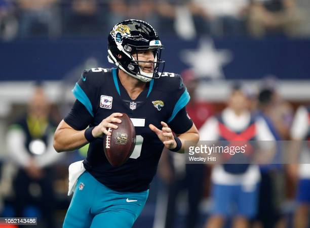 Blake Bortles of the Jacksonville Jaguars loos to pass in the first quarter of a game against the Dallas Cowboys at ATT Stadium on October 14 2018 in...