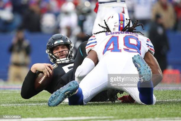 Blake Bortles of the Jacksonville Jaguars reacts after being tackled by Tremaine Edmunds of the Buffalo Bills in the third quarter during NFL game...
