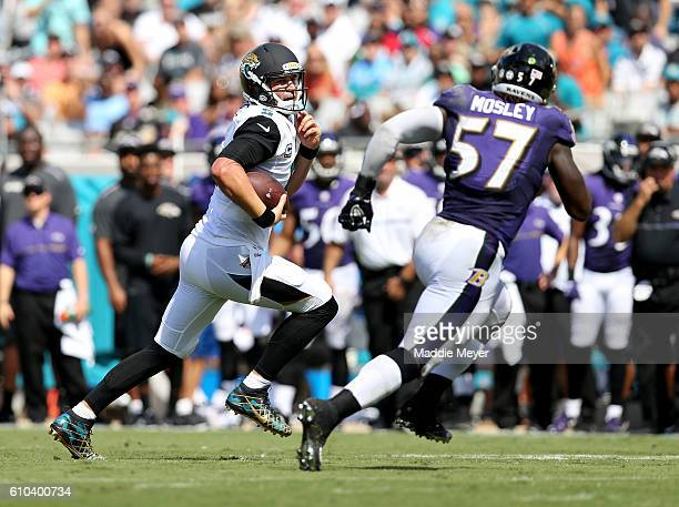 Blake Bortles of the Jacksonville Jaguars runs for yardage as he's chased by CJ Mosley of the Baltimore Ravens at EverBank Field on September 25 2016...