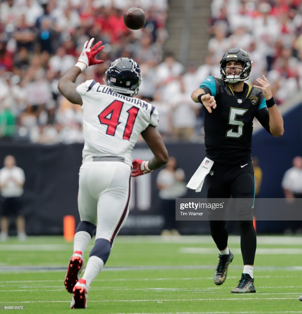 Blake Bortles #5 of the Jacksonville Jaguars thows a pass in the first quarter defended by Zach Cunningham #41 of the Houston Texans at NRG Stadium on September 10, 2017 in Houston, Texas.