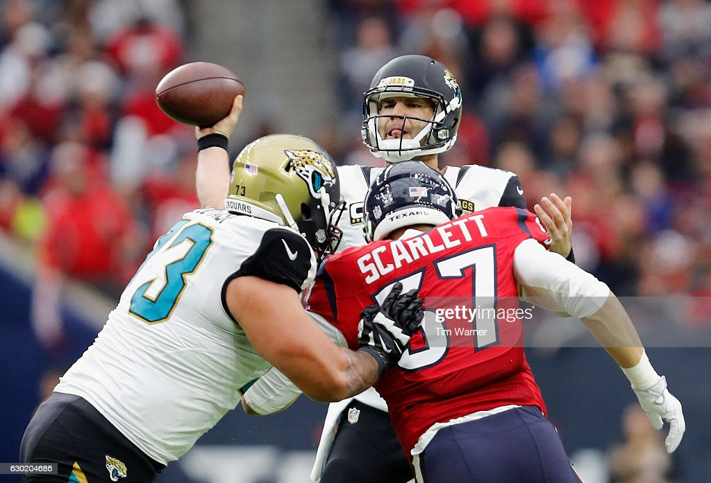 Blake Bortles #5 of the Jacksonville Jaguars throws a pass under pressure by Brennan Scarlett #57 of the Houston Texans in the first quarter at NRG Stadium on December 18, 2016 in Houston, Texas.