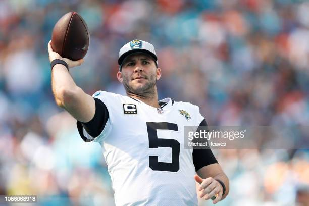 Blake Bortles of the Jacksonville Jaguars warms up on the sideline in the first half against the Miami Dolphins at Hard Rock Stadium on December 23,...