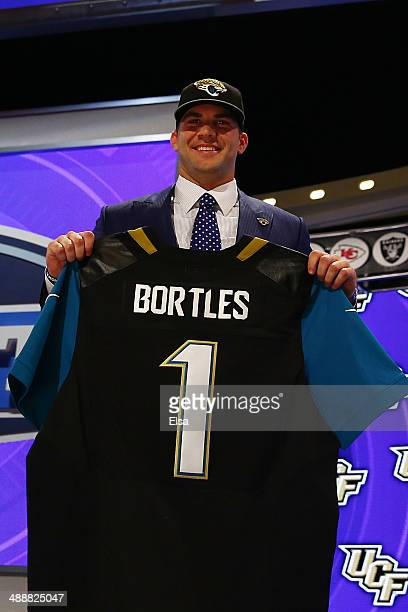 Blake Bortles of the UCF Knights poses with a jersey after he was picked overall by the Jacksonville Jaguars during the first round of the 2014 NFL...