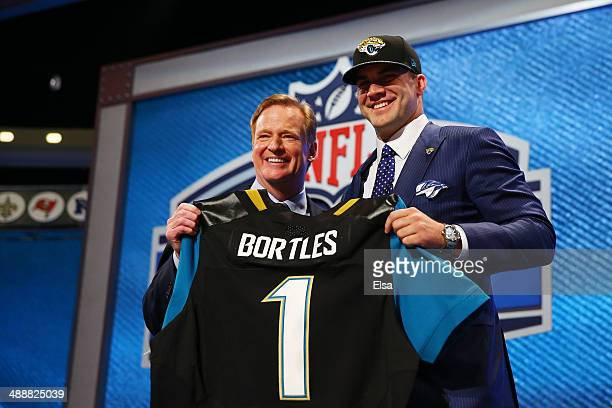 Blake Bortles of the UCF Knights poses with NFL Commissioner Roger Goodell after he was picked overall by the Jacksonville Jaguars during the first...