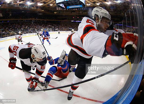 Blake Coleman and Adam Larsson of the New Jersey Devils check Raphael Diaz of the New York Rangers during their Pre Season game at Madison Square...