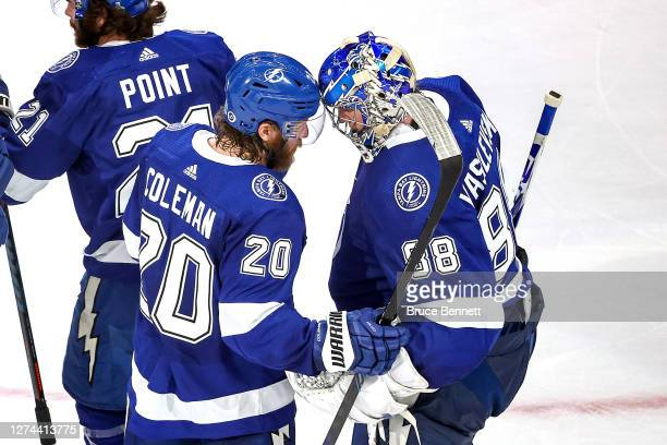 Blake Coleman and Andrei Vasilevskiy of the Tampa Bay Lightning celebrate the teams 32 victory against the Dallas Stars in Game Two of the 2020 NHL...