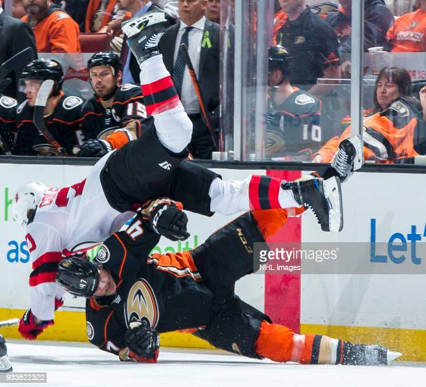 Blake Coleman of the New Jersey Devils and Hampus Lindholm of the Anaheim Ducks collide during the third period of the game at Honda Center on March...