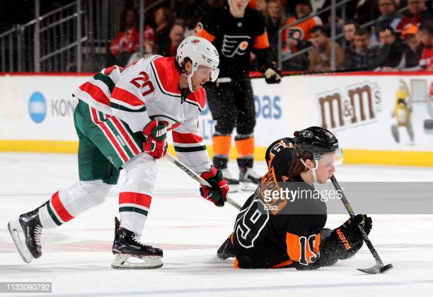 Blake Coleman of the New Jersey Devils and Nolan Patrick of the Philadelphia Flyers fight for the puck in the second period on March 01 2019 at...
