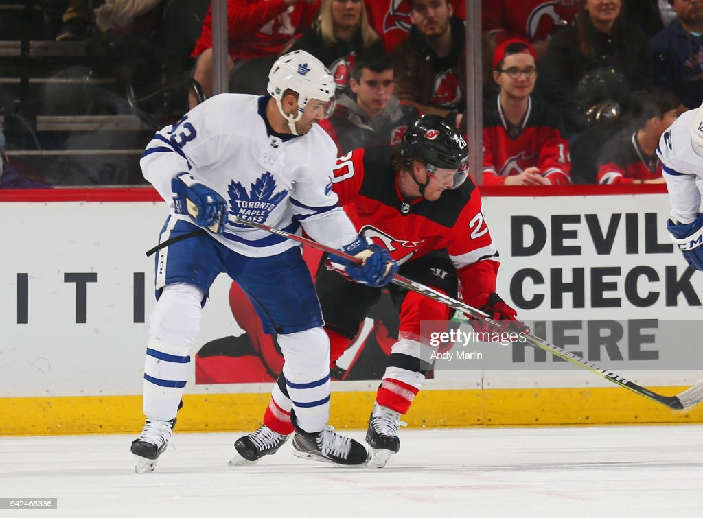Blake Coleman #20 of the New Jersey Devils battles for postion against Nazem Kadri #43 of the Toronto Maple Leafs during the game at Prudential Center on April 5, 2018 in Newark, New Jersey.