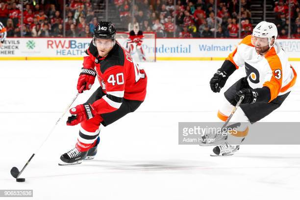 Blake Coleman of the New Jersey Devils in action in front of Radko Gudas of the Philadelphia Flyers during the second period at the Prudential Center...