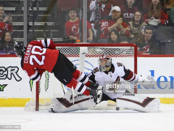 Blake Coleman of the New Jersey Devils scores in the shootout against Darcy Kuemper of the Arizona Coyotes at the Prudential Center on March 23 2019...