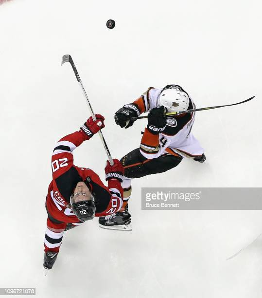 Blake Coleman of the New Jersey Devils skates against Cam Fowler of the Anaheim Ducks at the Prudential Center on January 19, 2019 in Newark, New...