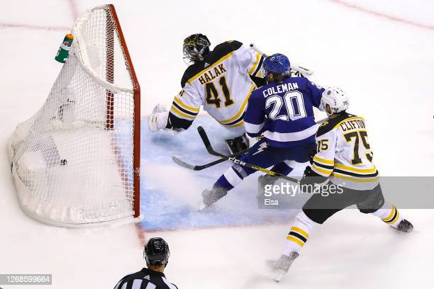 Blake Coleman of the Tampa Bay Lightning scores a goal past Jaroslav Halak of the Boston Bruins during the third period in Game Two of the Eastern...