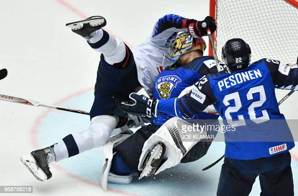 Blake Coleman of the United States crashes with Finland's goalkeeper Harri Sateri during the group B match Finland vs the United States of the 2018...