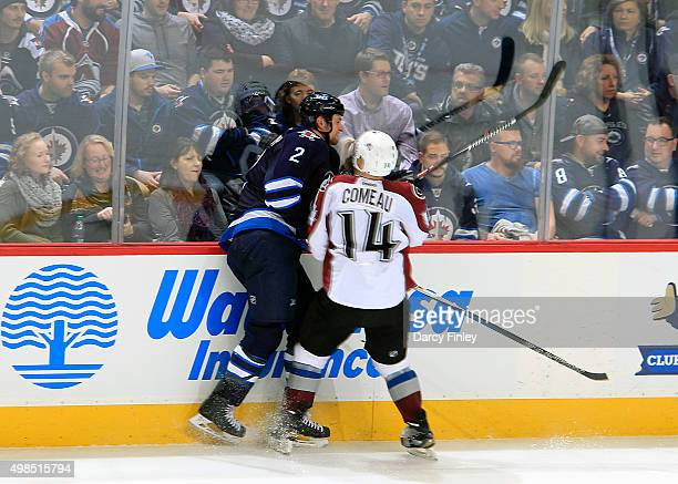 Blake Comeau of the Colorado Avalanche checks Adam Pardy of the Winnipeg Jets into the boards during second period action at the MTS Centre on...