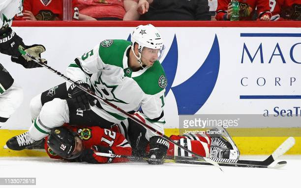 Blake Comeau of the Dallas Stars lands on top of Alex DeBrincat of the Chicago Blackhawks at the United Center on February 24 2019 in Chicago...