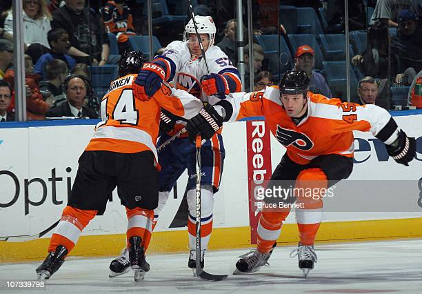 Blake Comeau of the New York Islanders attempts to get past Kimmo Timonen and Jody Shelley of the Philadelphia Flyers at the Nassau Coliseum on...