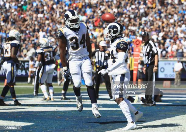 Blake Countess of the Los Angeles Rams celebrates his recovery for a touchdown off of a blocked punt with teammate Malcolm Brown during the second...