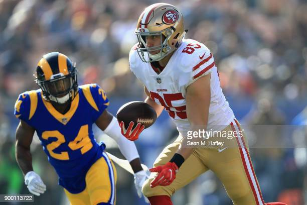 Blake Countess of the Los Angeles Rams chases George Kittle of the San Francisco 49ers on a short pass play during the first half of a game at Los...
