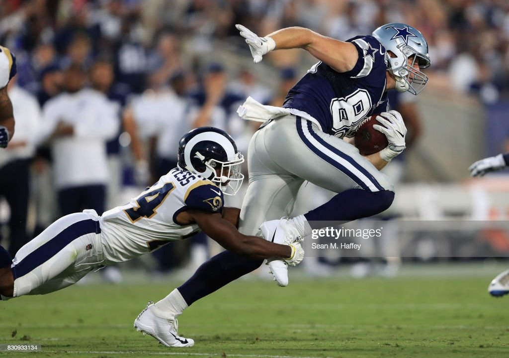 Blake Countess #24 of the Los Angeles Rams tackles Blake Jarwin #89 of the Dallas Cowboys during the second half of a presason game at Los Angeles Memorial Coliseum on August 12, 2017 in Los Angeles, California.