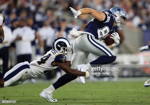 Blake Countess of the Los Angeles Rams tackles Blake Jarwin of the Dallas Cowboys during the second half of a presason game at Los Angeles Memorial...