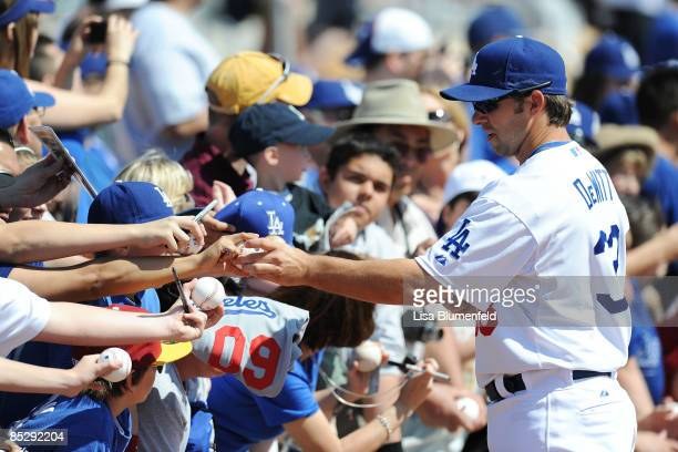 Blake DeWitt of the Los Angeles Dodgers signs autographs before a Spring Training game against the Seattle Mariners at Camelback Ranch on March 7...