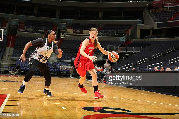 Blake Dietrick of the Washington Mystics drives against Monica Wright of the Minnesota Lynx during an Analytic Scrimmage at the Verizon Center on May...
