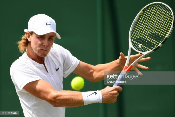 Blake Ellis of Australia plays a backhand during the Boy's Singles first round match against Trent Bryde of the United States on day seven of the...