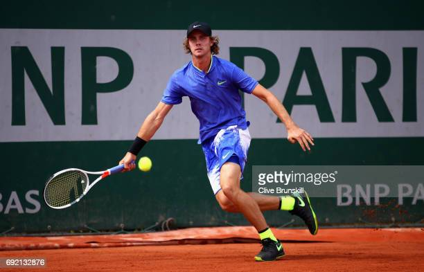 Blake Ellis of Australia plays a forehand during the boys singles first round match against Sebastian Baez of Argentina on day eight of the 2017...