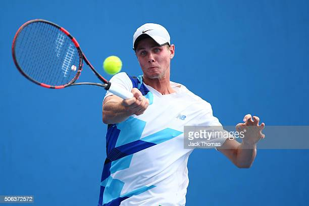 Blake Ellis of Australia plays a forehand in his first round juniors match against Yibing Wu of China during the Australian Open 2016 Junior...