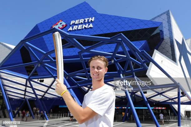 Blake Ellis poses with the Queen's Baton for the 2018 Commonwealth Games during the 2018 Hopman Cup at Perth Arena on December 31 2017 in Perth...