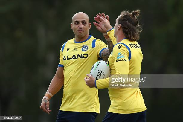Blake Ferguson and Clinton Gutherson of the Eels train during a Parramatta Eels NRL training session at Kellyville Park on March 09, 2021 in Sydney,...