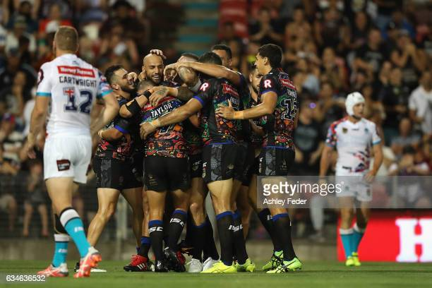 Blake Ferguson and Joel Thompson of the Indigenous All Stars celebrate a try from Ashley Taylor during the NRL All Stars match between the 2017...