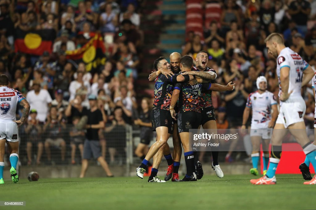 Blake Ferguson (C) and Joel Thompson (R) of the Indigenous All Stars celebrate a try from Ashley Taylor during the NRL All Stars match between the 2017 Harvey Norman All Stars and the NRL World All Stars at McDonald Jones Stadium on February 10, 2017 in Newcastle, Australia.