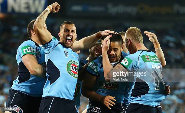 Blake Ferguson Jarryd Hayne and Luke Lewis of the Blues celebrate a try by Jarryd Hayne during game one of the ARL State of Origin series between the...