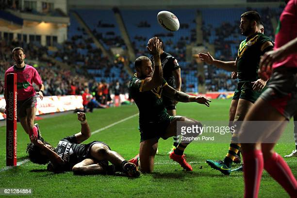 Blake Ferguson of Australia celebrates scoring a try during the Four Nations match between the New Zealand and Australia at The Ricoh Arena on...