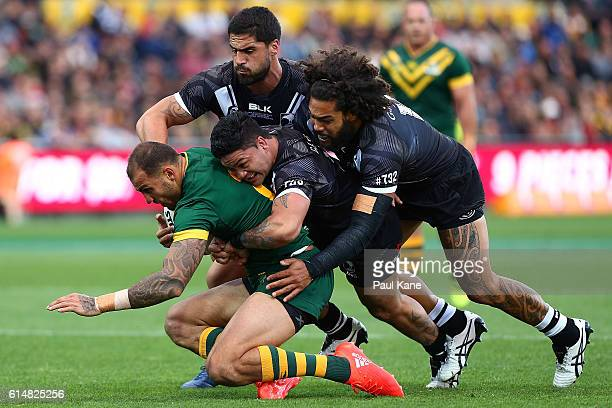 Blake Ferguson of Australia gets tackled by Jesse Bromwich Issac Luke and Adam Blair of New Zealand during the International Rugby League Test match...