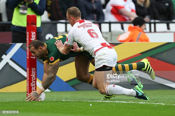 Blake Ferguson of Australia scores a try despite Kevin Brown of England best effort to stop him during the Four Nations between England against...