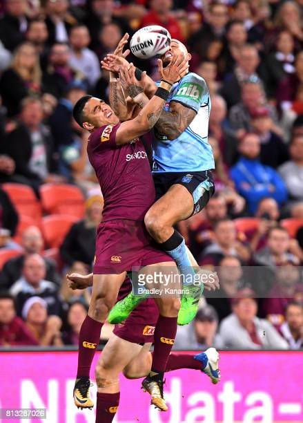 Blake Ferguson of the Blues and Valentine Holmes of the Maroons compete for the ball during game three of the State Of Origin series between the...