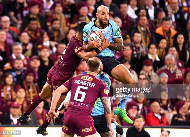 Blake Ferguson of the Blues and Valentine Holmes of the Maroons challenge for the ball during game three of the State Of Origin series between the...