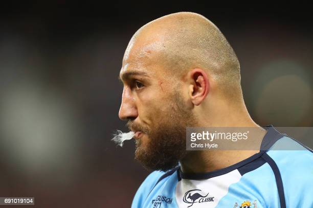 Blake Ferguson of the Blues looks on during game one of the State Of Origin series between the Queensland Maroons and the New South Wales Blues at...