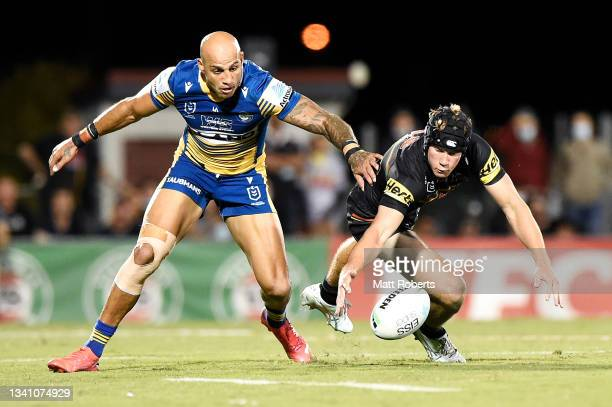 Blake Ferguson of the Eels and Matt Burton of the Panthers compete for the ball during the NRL Semifinal match between the Penrith Panthers and the...